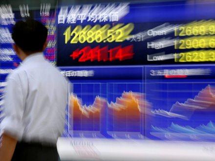 Wall Street jumps at open on Goldman's profit beat, vaccine hopes